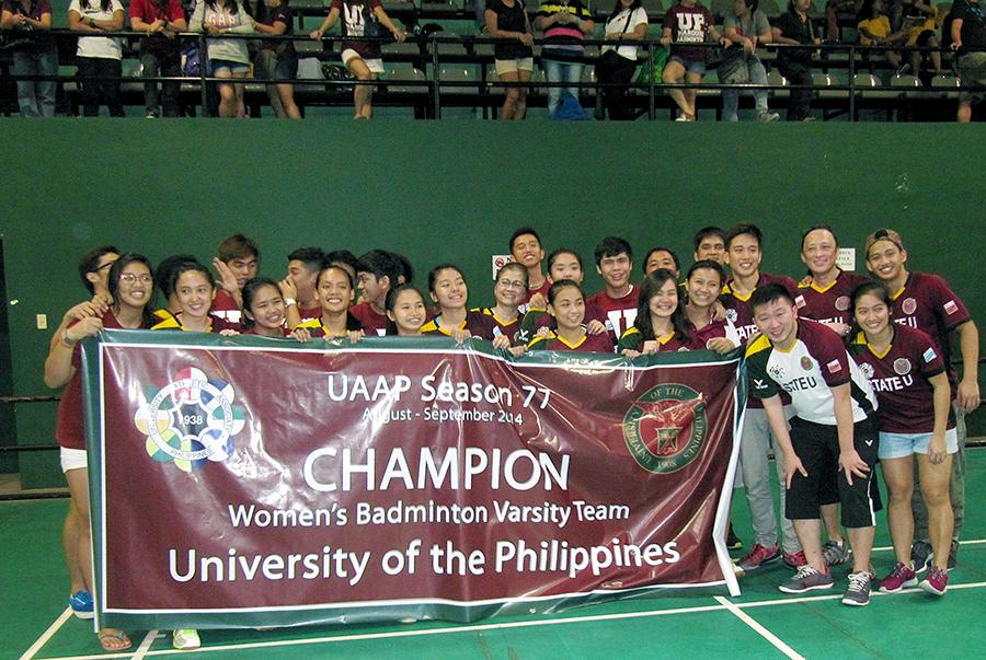 The UAAP Season 77 champion UP Women's Badminton Team with head coach Tosi Alcasid, Coach Malvin Alcala, Training Coach Jeremy Kok and the men's team at the Rizal Memorial Badminton Hall Sept. 10.