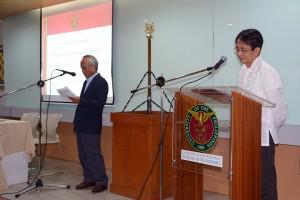 Solon (left) is affirmed as UP School of Economics Dean  before UPD Chancellor Michael L. Tan. (right