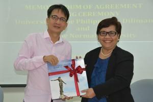 Chancellor Michael L. Tan and PNU President Ester B. Ogena